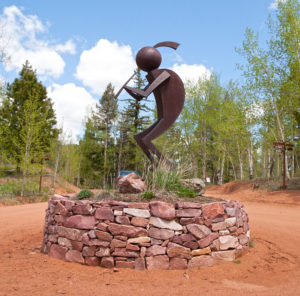 """The Flute"" Kokopelli in Bronze by Paul Hathaway, 1980. Located at Aspen Valley Ranch, Woodland Park, Colorado."